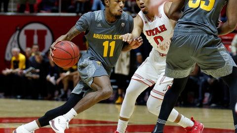 Arizona State guard Shannon Evans II (11) drives around Utah guard Sedrick Barefield (0) in the first half during an NCAA college basketball game Sunday, Jan. 7, 2018, in Salt Lake City. Arizona State won, 80-77. (AP Photo/Rick Bowmer)