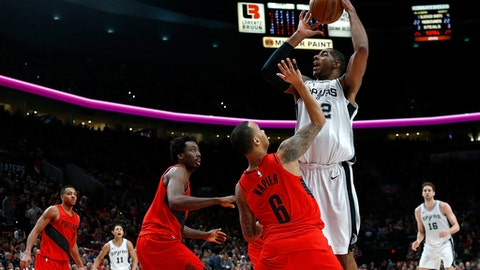 PORTLAND, OR - JANUARY 07:  LaMarcus Aldridge #12 of the San Antonio Spurs battles against Shabazz Napier #6 of the Portland Taril Blazers at Moda Center on January 7, 2018 in Portland, Oregon.OTE TO USER: User expressly acknowledges and agrees that, by downloading and or using this photograph, User is consenting to the terms and conditions of the Getty Images License Agreement.  (Photo by Jonathan Ferrey/Getty Images)