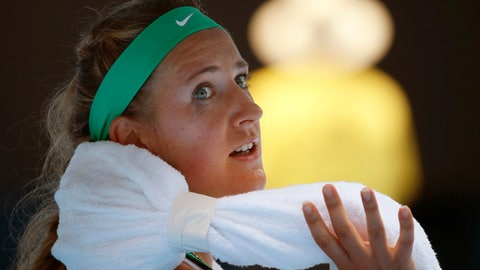 FILE - In this Jan. 27, 2016, file photo, Victoria Azarenka of Belarus wraps an ice towel around her neck during a break in her quarterfinal match against Angelique Kerber of Germany at the Australian Open tennis championships in Melbourne, Australia. Two-time champion Azarenka has withdrawn from the 2018 Australian Open, with her wildcard entry to the season's first major reallocated to Ajla Tomljanovic, Australian Open organizers announced in a social media post Monday, Jan. 8, 2018, a week before the tournament begins. (AP Photo/Vincent Thian, File)