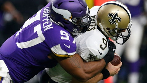 FILE - In this Sept. 11, 2017, file photo, New Orleans Saints quarterback Drew Brees (9) is sacked by Minnesota Vikings defensive end Everson Griffen (97) during the first half of an NFL football game in Minneapolis. The Vikings finally have their first postseason opponent set with the Saints, a team they beat handily in the opener when both teams looked a lot different than they do now. (AP Photo/Jim Mone, File)