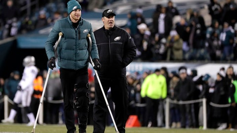 FILE - In this Dec. 25, 2017, file photo, Philadelphia Eagles' Carson Wentz, left, walks with head coach Doug Pederson, right, before an NFL football game against the Oakland Raiders in Philadelphia. Wentz's value to the Philadelphia Eagles is reflected clearly in an historic betting line. (AP Photo/Michael Perez, File)