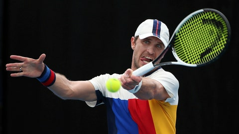 Germany's Mischa Zverev hits a forehand to Leonardo Mayer of Argentina during their match at the Sydney International tennis tournament in Sydney, Tuesday, Jan. 9, 2018. (AP Photo/Rick Rycroft)