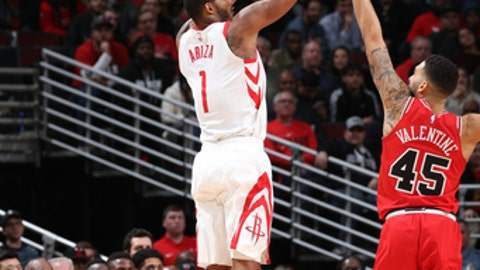 CHICAGO, IL - JANUARY 8:  Trevor Ariza #1 of the Houston Rockets shoots the ball against the Chicago Bulls on January 8, 2018 at the United Center in Chicago, Illinois. NOTE TO USER: User expressly acknowledges and agrees that, by downloading and or using this Photograph, user is consenting to the terms and conditions of the Getty Images License Agreement. Mandatory Copyright Notice: Copyright 2018 NBAE (Photo by Gary Dineen/NBAE via Getty Images)