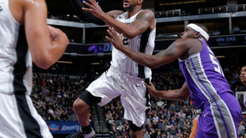 SACRAMENTO, CA - JANUARY 8:  LaMarcus Aldridge #12 of the San Antonio Spurs goes to the basket during the game against the Sacramento Kings on January 8, 2018 at Golden 1 Center in Sacramento, California. NOTE TO USER: User expressly acknowledges and agrees that, by downloading and or using this Photograph, user is consenting to the terms and conditions of the Getty Images License Agreement. Mandatory Copyright Notice: Copyright 2018 NBAE (Photo by Rocky Widner/NBAE via Getty Images)