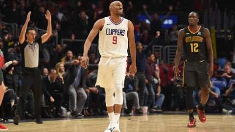 LOS ANGELES, CA - JANUARY 08: Los Angeles Clippers Forward C.J. Williams (9) celebrates after shooting the eventual game winning three pointer during an NBA game between the Atlanta Hawks and the Los Angeles Clippers on January 08, 2018 at STAPLES Center in Los Angeles, CA. (Photo by Chris Williams/Icon Sportswire via Getty Images)