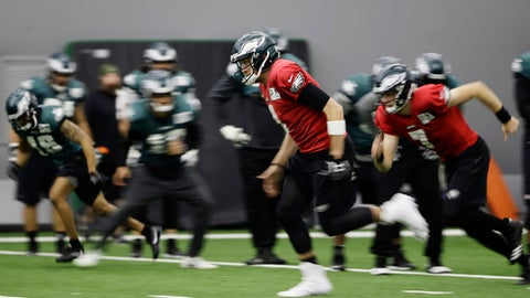In this image taken with a slow shutter speed, Philadelphia Eagles quarterback Nick Foles, center, runs a drill during practice at the team's NFL football training facility in Philadelphia, Tuesday, Jan. 9, 2018. (AP Photo/Matt Rourke)
