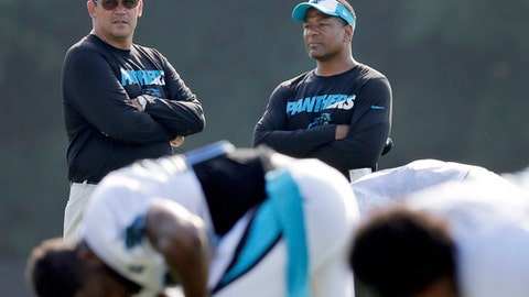FILE - In this Aug. 3, 2015, file photo, Carolina Panthers head coach Ron Rivera, left, talks with assistant head coach Steve Wilks, right, as players warm up during the NFL football team's training camp in Spartanburg, S.C. The New York Giants have Wilks for their vacant head coaching job on Tuesday, Jan. 9, 2018. (AP Photo/Chuck Burton, File)
