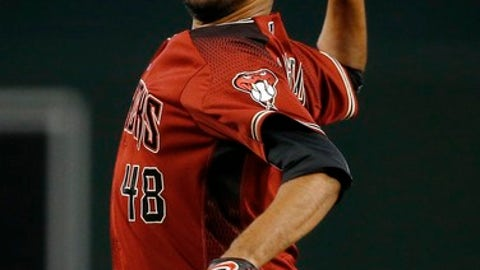 Arizona Diamondbacks' Randall Delgado throws a pitch against the Philadelphia Phillies during the first inning of a baseball game Sunday, June 25, 2017, in Phoenix. (AP Photo/Ross D. Franklin)
