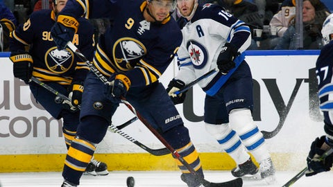 Buffalo Sabres forward Evander Kane (9) passes the puck during the first period of an NHL hockey game against the Winnipeg Jets, Tuesday, Jan. 9, 2018, in Buffalo, N.Y. (AP Photo/Jeffrey T. Barnes)