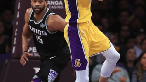 LOS ANGELES, CA - JANUARY 09:  Lonzo Ball #2 of the Los Angeles Lakers passes the ball as Vince Carter #15 of the Sacramento Kings looks on during the second half of a game at Staples Center on January 9, 2018 in Los Angeles, California.   NOTE TO USER: User expressly acknowledges and agrees that, by downloading and or using this photograph, User is consenting to the terms and conditions of the Getty Images License Agreement.  (Photo by Sean M. Haffey/Getty Images)