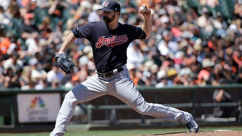 FILE - In this July 19, 2017, file photo, Cleveland Indians pitcher Boone Logan throws against the San Francisco Giants during a baseball game in San Francisco. Reliever Boone Logan and the Milwaukee Brewers have finalized a $2.5 million, one-year contract. The 33-year-old left-hander was 1-0 with a 4.71 ERA in 38 games for Cleveland last year, striking out 28 in 21 innings. (AP Photo/Jeff Chiu, File)