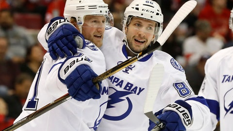 FILE - In this Tuesday, Nov. 15, 2016 file photo, Tampa Bay Lightning center Steven Stamkos, left, celebrates his goal against the Detroit Red Wings with Nikita Kucherov in the first period of an NHL hockey game in Detroit. Winger Nikita Kucherov, defenseman Victor Hedman and Andrei Vasilevskiy will join Lightning captain Steven Stamkos at NHL All-Star Weekend in Tampa, Florida. With four players on the Atlantic Division team, host and league-leading Tampa Bay has the most representatives for the skills competition and 3-on-3 tournament Jan. 27-28 at Amalie Arena. (AP Photo/Paul Sancya, File)