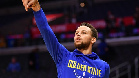 LOS ANGELES, CA - JANUARY 06: Golden State Warriors Guard Stephen Curry (30) shoots before an NBA game between the Golden State Warriors and the Los Angeles Clippers on January 06, 2018 at STAPLES Center in Los Angeles, CA. (Photo by Brian Rothmuller/Icon Sportswire via Getty Images)