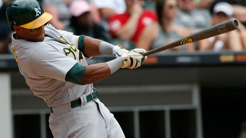 FILE - In this Sunday, June 25, 2017 file photo, Oakland Athletics' Khris Davis hits an RBI-single against the Chicago White Sox during the eighth inning of a baseball game in Chicago. Slugger Khris Davis and the Oakland Athletics agreed to a $10.5 million, one-year contract, more than doubling his salary after he beat the team in arbitration last winter, Wednesday, Jan. 10, 2018. (AP Photo/Nam Y. Huh, File)