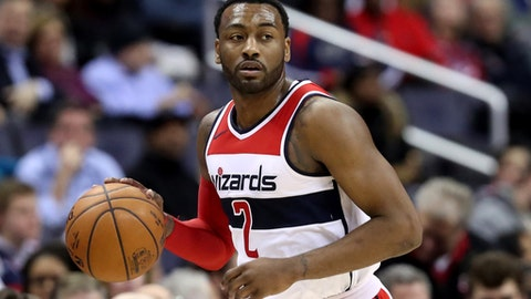 WASHINGTON, DC - JANUARY 10: John Wall #2 of the Washington Wizards dribbles the ball against the Utah Jazz in the first half at Capital One Arena on January 10, 2018 in Washington, DC. NOTE TO USER: User expressly acknowledges and agrees that, by downloading and or using this photograph, User is consenting to the terms and conditions of the Getty Images License Agreement. (Photo by Rob Carr/Getty Images)