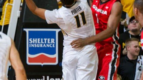 Georgia's Yante Maten, right, tries to block the shot of Missouri's Jontay Porter, left, during the first half of an NCAA college basketball game Wednesday, Jan. 10, 2018, in Columbia, Mo. (AP Photo/L.G. Patterson)