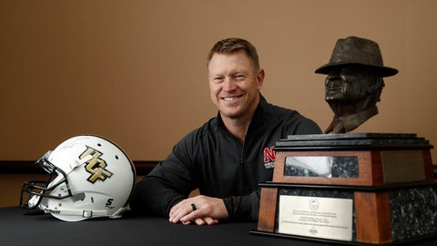 """Nebraska football coach Scott Frost, formerly with Central Florida, poses with the Paul """"Bear"""" Bryant award ahead of the 32nd annual Paul """"Bear"""" Bryant Awards, Wednesday, Jan. 10, 2018, in Houston. (Karen Warren/Houston Chronicle via AP)"""