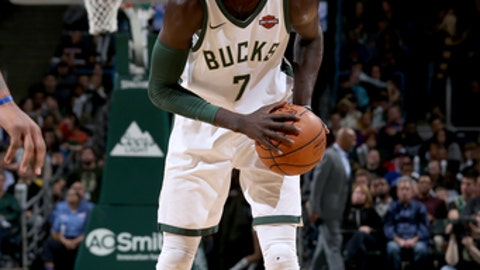 MILWUAKEE, WI - JANUARY 10:  Thon Maker #7 of the Milwaukee Bucks handles the ball against the Orlando Magic on January 10, 2018 at the BMO Harris Bradley Center in Milwaukee, Wisconsin. NOTE TO USER: User expressly acknowledges and agrees that, by downloading and or using this Photograph, user is consenting to the terms and conditions of the Getty Images License Agreement. Mandatory Copyright Notice: Copyright 2018 NBAE (Photo by Gary Dineen/NBAE via Getty Images)