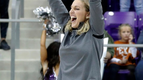 TCU coach Raegan Pebbley celebrates the team's 79-77 win over Texas in an NCAA college basketball game Wednesday, Jan. 10, 2018, in Fort Worth, Texas. (AP Photo/Tony Gutierrez)