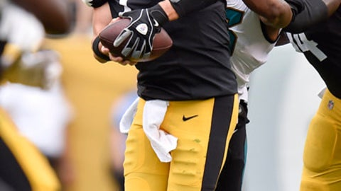 FILE - In this file photo from Oct. 8, 2017, Jacksonville Jaguars defensive end Dante Fowler (56) sacks Pittsburgh Steelers quarterback Ben Roethlisberger (7) in an NFL football game, in Pittsburgh. Three months later, Roethlisberger doesn't want to talk about that five-interception meltdown against Jacksonville, a shot at redemption awaits Sunday in the playoffs. (AP Photo/Don Wright, File)