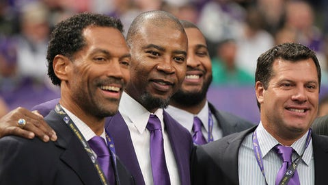 FILE - In this Dec. 15, 2013, file photo, former Minnesota Vikings players, from left, Steve Jordan, Chris Doleman, Daunte Culpepper and Ryan Longwell pose for a photo before a ceremony honoring the All Mall of America Field team during half time of an NFL football game between the Vikings and the Philadelphia Eagles, in Minneapolis. Newly named All-Pro for the first time, Saints defensive Cam Jordan takes his playful yet menacing presence this weekend to the city where his father, Steve Jordan, became a Pro Bowl tight end. (AP Photo/Andy King, File)