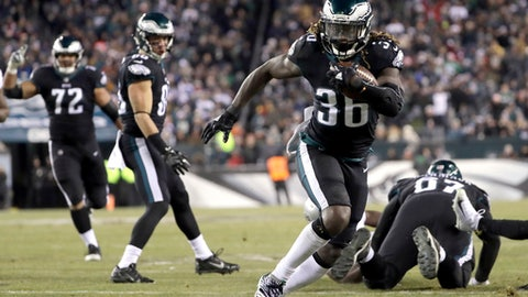 "FILE - In this Dec. 25, 2017, file photo, Philadelphia Eagles' Jay Ajayi (36) runs for a touchdown during the first half of an NFL football game against the Oakland Raiders, in Philadelphia.  The Eagles can jump aboard the Jay Train when they host Atlanta in an NFC divisional playoff Saturday and try to ride Ajayi to the conference title game. ""I feel really good, like, I feel really good,"" said Ajayi, who has been bothered by knee issues.  (AP Photo/Michael Perez)"