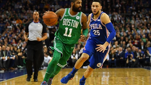 LONDON, ENGLAND - JANUARY 11:  Kyrie Irving #11 of the Boston Celtics holds off Ben Simmons #25 of the Philadelphia 76ers during the NBA game between Boston Celtics and Philadelphia 76ers at The O2 Arena on January 11, 2018 in London, England. (Photo by Dan Mullan/Getty Images)