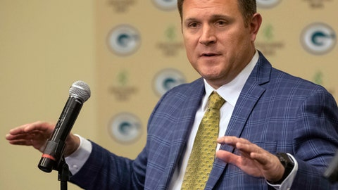 FILE - In this Jan. 8, 2018, file photo, New Green Bay Packers NFL football team general manager Brian Gutekunst gestures while speaking at an introductory news conference in Green Bay, Wis. A life around football has prepared Gutekunst for his new job as the GM of the Packers. (AP Photo/Mike Roemer, File)
