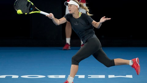 Denmark's Caroline Wozniacki makes a forehand return during a practice session on Rod Laver Arena ahead of the Australian Open tennis championships in Melbourne, Australia Friday, Jan. 12, 2018. (AP Photo/Mark Baker)