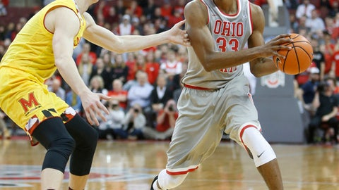 Ohio State's Keita Bates-Diop, right, looks for an open pass as Maryland's Kevin Huerter defends during the second half of an NCAA college basketball game Thursday, Jan. 11, 2018, in Columbus, Ohio. (AP Photo/Jay LaPrete)