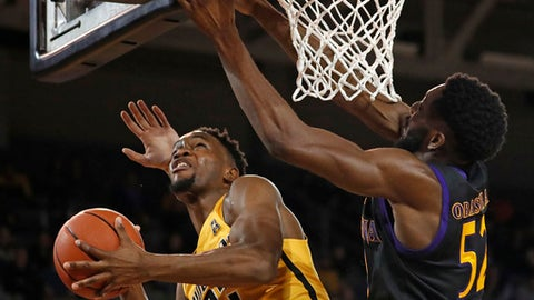 Wichita State's Markis McDuffie (32) tries to get under East Carolina's Justice Obasohan (52) during the first half of an NCAA college basketball game in Greenville, N.C., Thursday, Jan. 11, 2018. (AP Photo/Karl B DeBlaker)