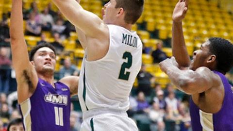 William & Mary's Matt Milon drives to the basket around James Madison's Zach Jacobs, left, during an NCAA college basketball game Thursday, Jan. 11, 2018, in Williamsburg, Va. (Jonathon Gruenke/The Daily Press via AP)