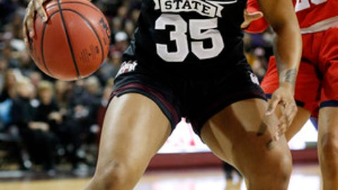 Mississippi State guard Victoria Vivians (35) drives past Mississippi guard Madinah Muhammad (20) during the first half of an NCAA college basketball game in Starkville, Miss., Thursday, Jan. 11, 2018. (AP Photo/Rogelio V. Solis)