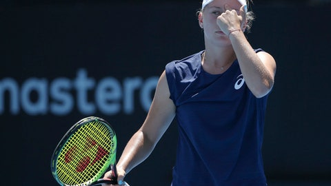 Daria Gavrilova of Australia points to her head while playing compatriot Ash Barty during their women's semifinal singles match at the Sydney International tennis tournament in Sydney, Friday, Jan. 12, 2018. (AP Photo/Rick Rycroft)