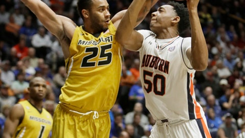 Auburn center Austin Wiley (50) drives against Missouri forward Russell Woods (25) during the first half of an NCAA college basketball game at the Southeastern Conference tournament Wednesday, March 8, 2017, in Nashville, Tenn. (AP Photo/Wade Payne)