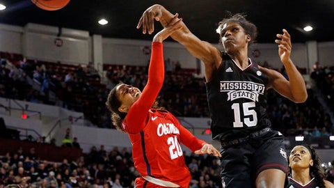 Mississippi State center Teaira McCowan (15) blocks a shot by Mississippi guard Madinah Muhammad (20) during the second half of an NCAA college basketball game in Starkville, Miss., Thursday, Jan. 11, 2018. Mississippi State won 76-45. (AP Photo/Rogelio V. Solis)