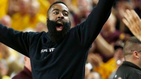 Former Arizona State basketball player and current Houston Rockets NBA player James Harden cheers along with the crowd during the first half of an NCAA college basketball game against Oregon, Thursday, Jan. 11, 2018, in Tempe, Ariz. (AP Photo/Ross D. Franklin)