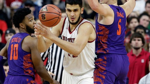 Clemson's Gabe DeVoe (10) and Mark Donnal (5) guard North Carolina State's Omer Yurtseven during the second half of an NCAA college basketball game in Raleigh, N.C., Thursday, Jan. 11, 2018. North Carolina State won 78-77. (AP Photo/Gerry Broome)