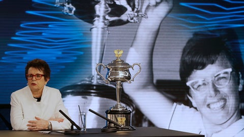 Billie Jean King, former ladies singles champion answers questions as she sits next to the Daphne Akhurst Memorial Cup during a press conference ahead of the Australian Open tennis championships in Melbourne, Australia Friday, Jan. 12, 2018. King is in Melbourne to celebrate the 50th anniversary of her Australian Open victory. (AP Photo/Mark Baker)