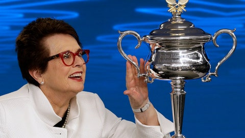 Billie Jean King, former ladies singles champion holds the Daphne Akhurst Memorial Cup during a press conference ahead of the Australian Open tennis championships in Melbourne, Australia Friday, Jan. 12, 2018. King is in Melbourne to celebrate the 50th anniversary of her Australian Open victory. (AP Photo/Mark Baker)