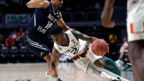 FILE - In this Nov. 25, 2017, file photo, Miami's Chris Lykes (2) drives to the basket as North Florida's Osborn Blount (10) defends during the second half of an NCAA college basketball game, in Coral Gables, Fla. Freshman guard Chris Lykes is only 5-7, but he made perhaps the biggest contribution to the latest win for the No. 18 Miami Hurricanes. (AP Photo/Lynne Sladky, File)