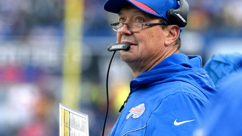 Buffalo Bills offensive coordinator Rick Dennison checks the scoreboard during the second half of an NFL football game against the Oakland Raiders, Sunday, Oct. 29, 2017, in Orchard Park, N.Y. Buffalo beat Oakland 34-14. (AP Photo/Adrian Kraus)
