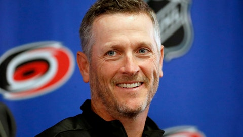 Carolina Hurricanes new NHL hockey team majority owner Thomas Dundon smiles during an introductory press conference at PNC Arena in Raleigh, N.C., Friday, Jan. 12, 2018. (Chris Seward/The News & Observer via AP)
