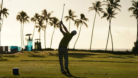 Zach Johnson hits off the 11th tee during the second round of the Sony Open golf tournament, Friday, Jan. 12, 2018, in Honolulu. (AP Photo/Marco Garcia)