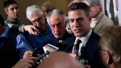 Chicago Cubs president of baseball operations Theo Epstein, right, talks to reporters during the Cubs' annual baseball convention Friday, Jan. 12, 2018, in Chicago. (AP Photo/Charles Rex Arbogast)