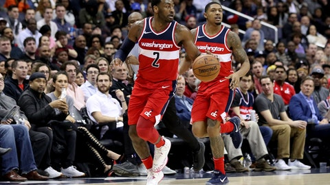 WASHINGTON, DC - JANUARY 12: Bradley Beal #3 of the Washington Wizards looks on as John Wall #2 dribbles the ball in the second half at Capital One Arena on January 12, 2018 in Washington, DC. NOTE TO USER: User expressly acknowledges and agrees that, by downloading and or using this photograph, User is consenting to the terms and conditions of the Getty Images License Agreement. (Photo by Rob Carr/Getty Images)