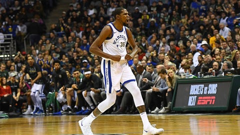MILWAUKEE, WI - JANUARY 12:  Kevin Durant #35 of the Golden State Warriors reacts to a three point shot by Draymond Green #23 during the second half of a game against the Milwaukee Bucks at the Bradley Center on January 12, 2018 in Milwaukee, Wisconsin.  NOTE TO USER: User expressly acknowledges and agrees that, by downloading and or using this photograph, User is consenting to the terms and conditions of the Getty Images License Agreement.  (Photo by Stacy Revere/Getty Images)