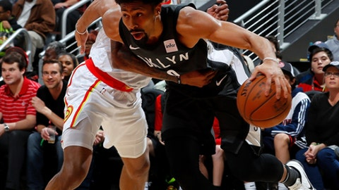 ATLANTA, GA - JANUARY 12:  Spencer Dinwiddie #8 of the Brooklyn Nets draws a foul from Kent Bazemore #24 of the Atlanta Hawks at Philips Arena on January 12, 2018 in Atlanta, Georgia.  NOTE TO USER: User expressly acknowledges and agrees that, by downloading and or using this photograph, User is consenting to the terms and conditions of the Getty Images License Agreement.  (Photo by Kevin C. Cox/Getty Images)