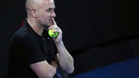 Novak Djokovic's coach Andre Agassi watches him train during a practice session ahead of the Australian Open tennis championships in Melbourne, Australia, Saturday, Jan. 13, 2018. (AP Photo/Ng Han Guan)