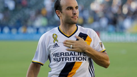 FILE - In this Sept. 11, 2016, file photo, Los Angeles Galaxy's Landon Donovan acknowledges fans after the team's MLS soccer match against Orlando City in Carson, Calif. Donovan says he is not ready to decide whether he will extend his MLS comeback for another season following the Galaxy's elimination from the playoffs. The Galaxy also had no news Wednesday, Nov. 9, on the career plans of Steven Gerrard and Robbie Keane. (AP Photo/Jae C. Hong. File)